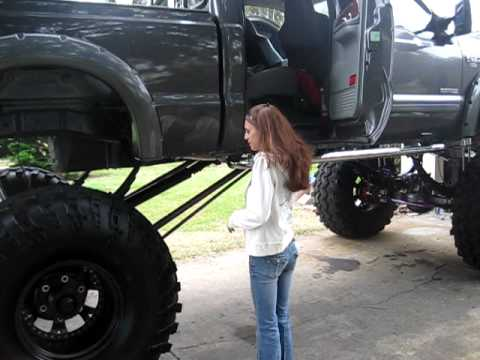 Woman Attempts To Climb Into A Giant Lifted Truck