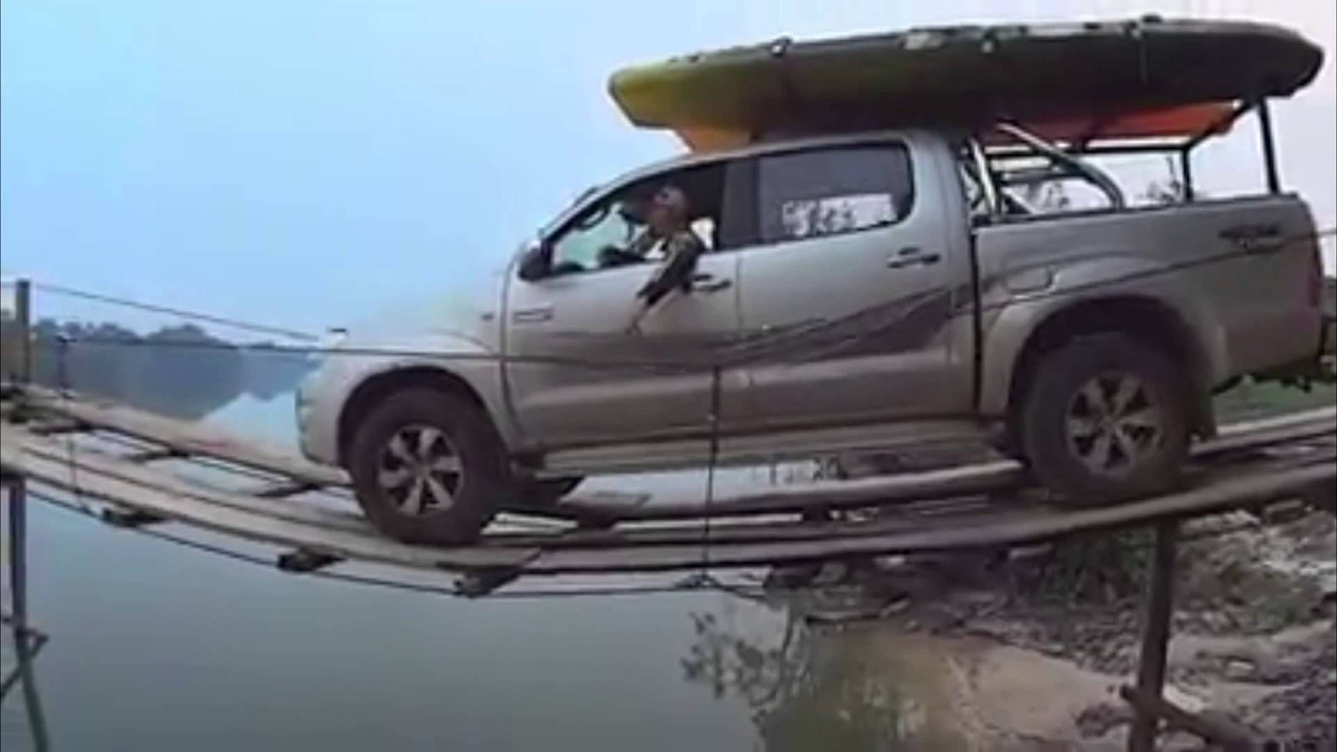 Insane Driver Goes Over A Thin Wooden Bridge With A Toyota