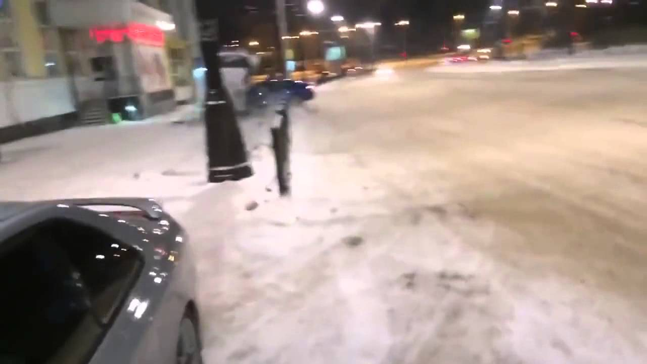 Audi A5 Quattro Snow Drifts, Loses Control and Annihilates a Bus Stop!