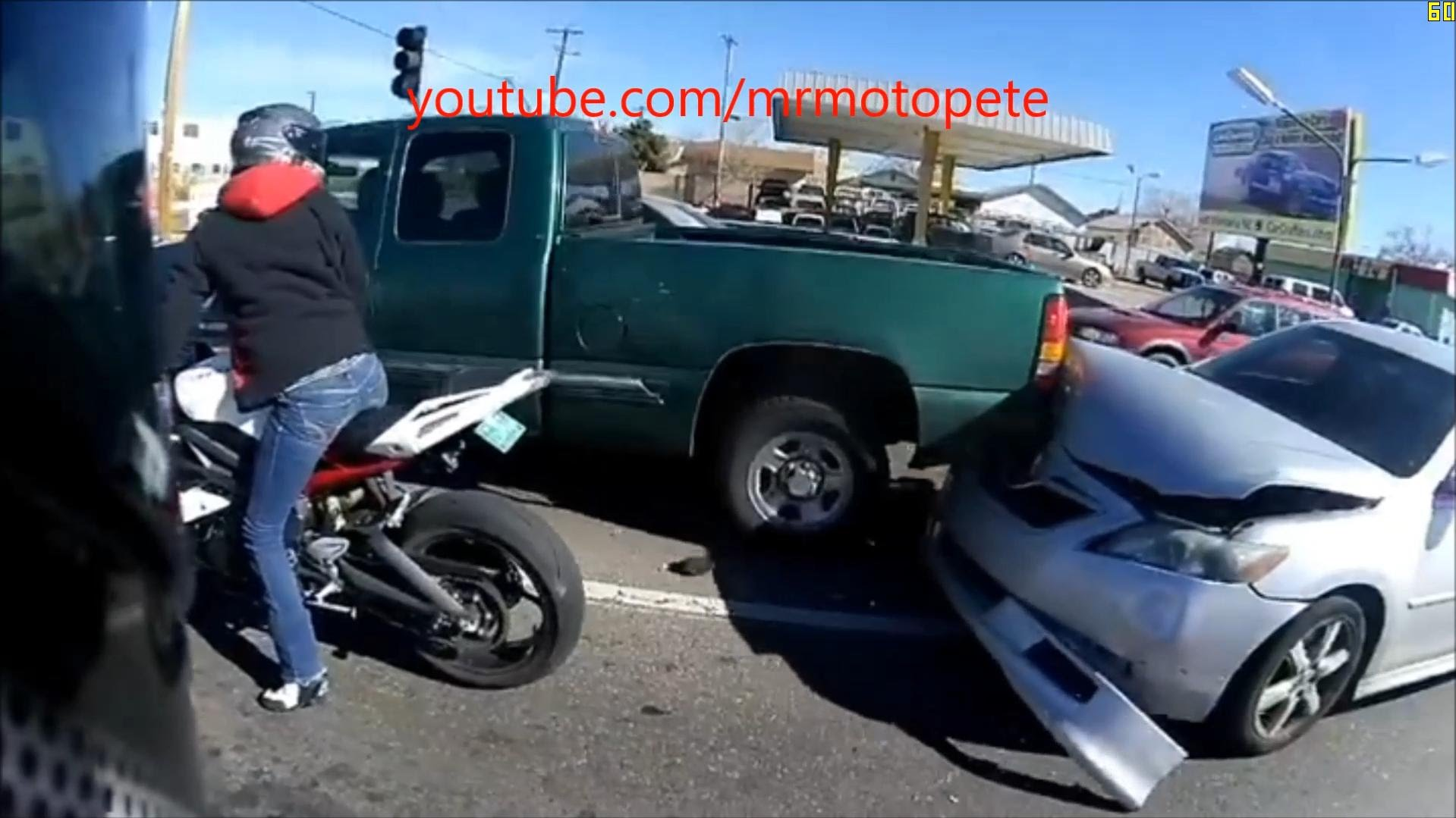 Driver Nearly Crashes Into Bikers After Missing A Red Light!
