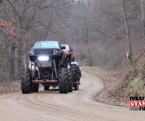 Giant Mega Truck Tows Big Mega Truck To Mud Bog And They Play Like Pigs In Slop!